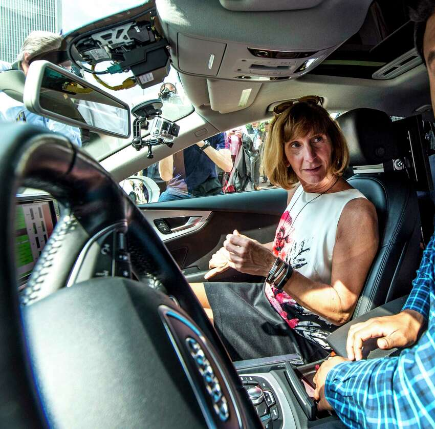 Theresa L. Egan, Commissioner of the NYS DMV, left speaks with an Audi of American engineer before getting a ride in an Audi A-1 with the new driverless technology on board at the State Capitol Tuesday June 13, 2017 on the in Albany, N.Y. (Skip Dickstein/Times Union)