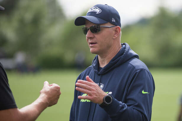 Offensive coordinator Darrell Bevell talks on the field following Seahawks minicamp on Tuesday, June 13, 2017.