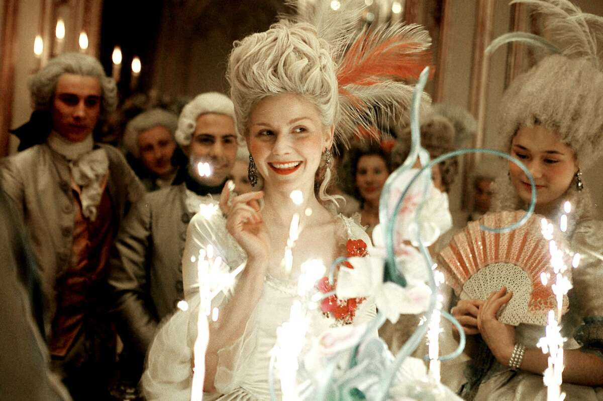 2 Caption: Kirsten Dunst (center) stars in the title role of Columbia Pictures' biographical drama Marie Antoinette. Photo Credit : Leigh Johnson.