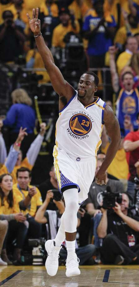 Draymond Green exults after a three-pointer in  Game 5. Green learned to control his emotions this season, drawing 15 technical fouls — but not the 16th that would have meant a suspension. Photo: Carlos Avila Gonzalez / The Chronicle / online_yes