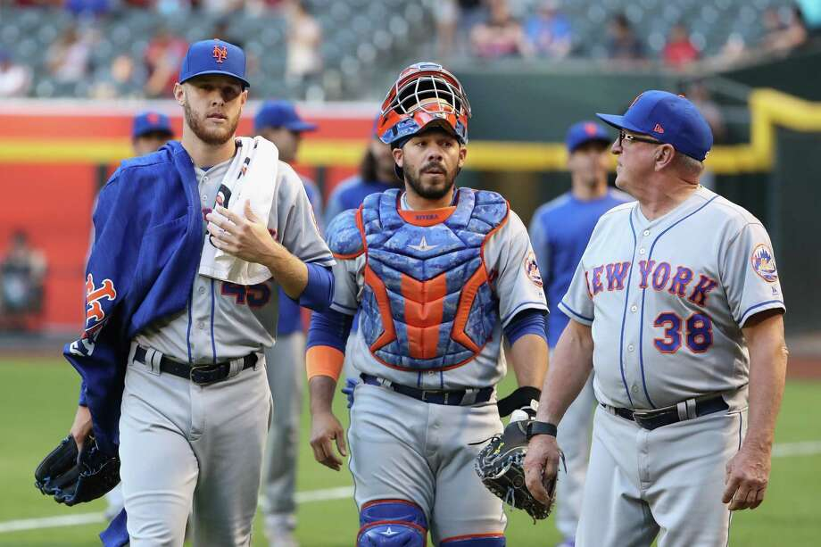 PHOENIX, AZ - MAY 15:  Starting pitcher Zack Wheeler #45, catcher Rene Rivera #44 and pitching coach Dan Warthen #38 of the New York Mets walk to the dugout before the MLB game against the Arizona Diamondbacks at Chase Field on May 15, 2017 in Phoenix, Arizona  (Photo by Christian Petersen/Getty Images) ORG XMIT: 700010807 Photo: Christian Petersen / 2017 Getty Images