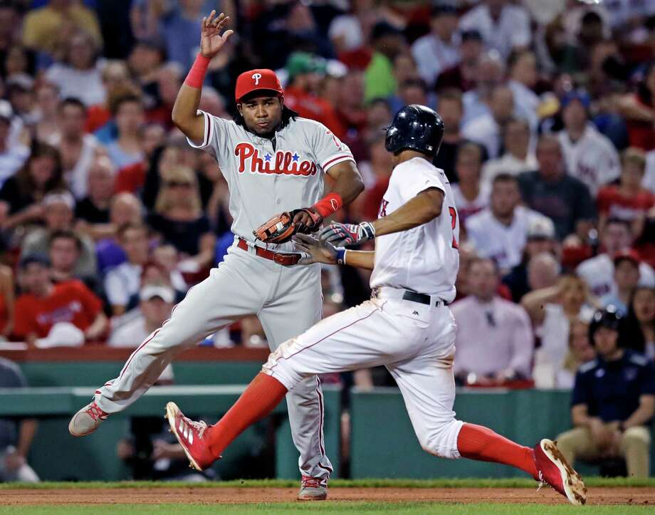 Philadelphia Phillies third baseman Maikel Franco, left, catches Boston Red Sox's Xander Bogaerts on an attempted steal of third during the fifth inning of a baseball game at Fenway Park in Boston, Tuesday, June 13, 2017. (AP Photo/Charles Krupa) ORG XMIT: MACK107 Photo: Charles Krupa / Copyright 2017 The Associated Press. All rights reserved.