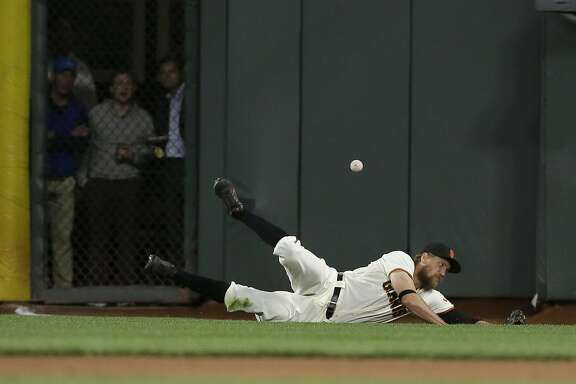 San Francisco Giants right fielder Hunter Pence cannot catch a three-run triple by Kansas City Royals' Whit Merrifield during the sixth inning of a baseball game in San Francisco, Tuesday, June 13, 2017. (AP Photo/Jeff Chiu)