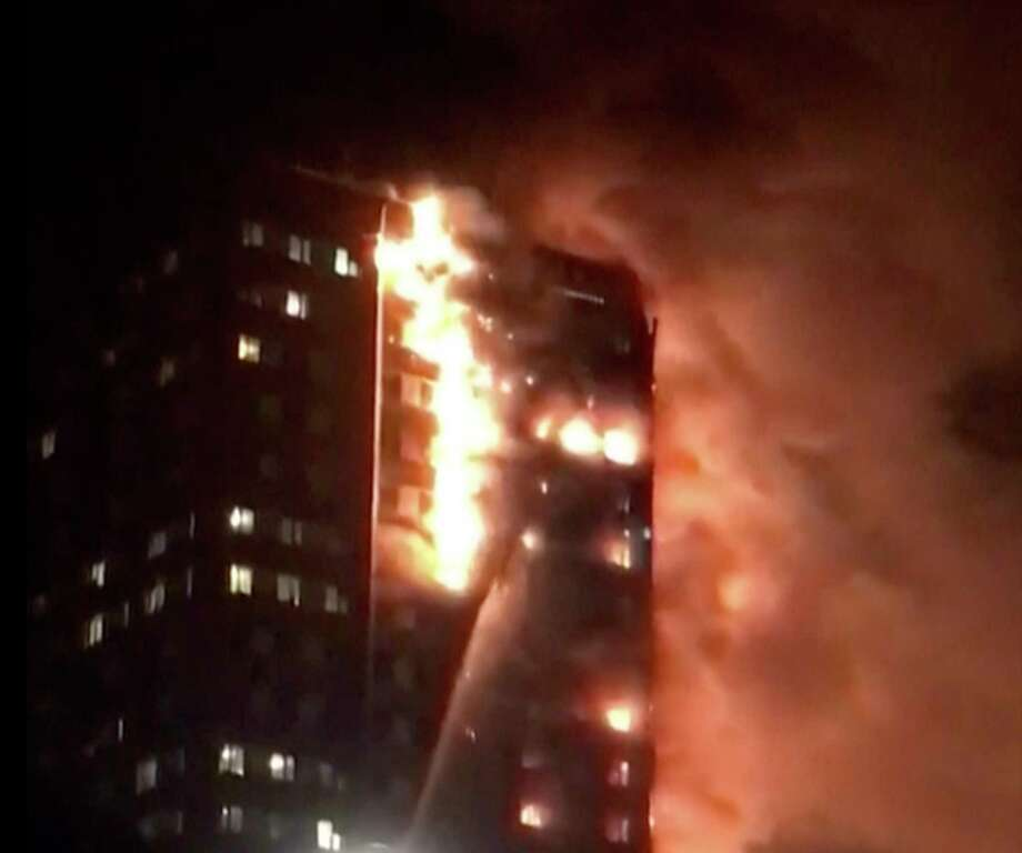 In this image made from video provided by Celeste Thomas @MAMAPIE, a building is on fire in London, Wednesday, June 14, 2017. Firefighters are battling a massive fire in an apartment high-rise in London. One side of the building appeared to be in flames. (Celeste Thomas @MAMAPIE via AP) Photo: UGC / Celeste Thomas @MAMAPIE