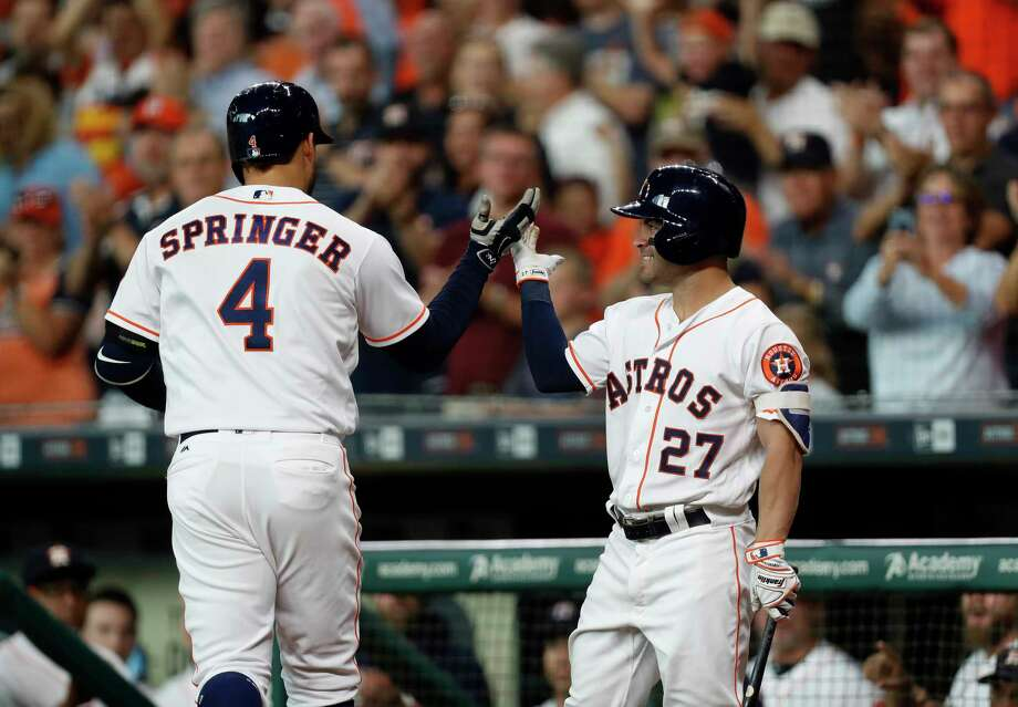 The Astros' George Springer is greeted by Jose Altuve after leading off Tuesday's bottom of the first with his 18th home run. Photo: Karen Warren, Staff Photographer / 2017 Houston Chronicle