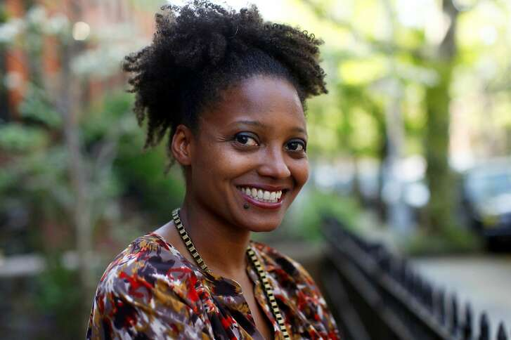 FILE - In this April 16, 2012 file photo, Pulitzer Prize winning poet Tracy K. Smith poses outside her apartment in New York. Smith is the country's new poet laureate. On Wednesday, the Library of Congress announced Smith's appointment to a one-year term. (AP Photo/Jason DeCrow, File)