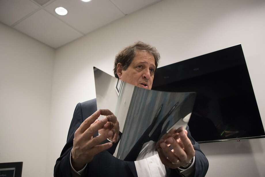 Thinfilm CEO Davor Sutija with a printed electronic flexible foil sheet. Photo: Paul Kuroda, Special To The Chronicle