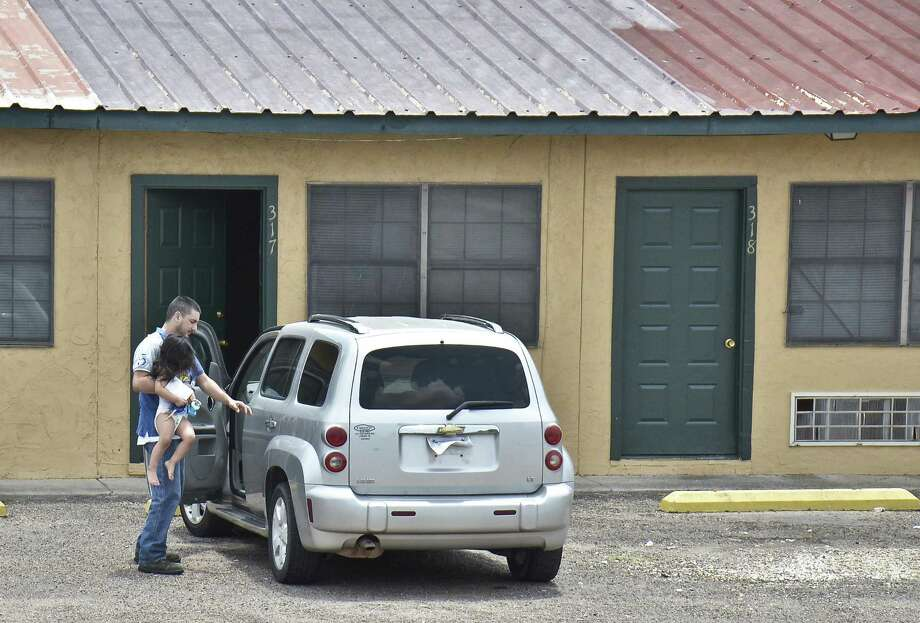 Members of the Vazquez family were among the residents of the Dellwood Apartments who were forced to evacuate there residence by the City of Laredo after the complex failed to meet minimum living standards. Photo: Ulysses S. Romero / Laredo Morning Times / Laredo Morning Times