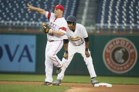 Reps. Cedric Richmond, D-La., right, and Steve Scalise, R-La., play during the Republicans' 8-7 victory in the 55th Congressional Baseball Game at Nationals Park, June 23, 2016. (Photo By Tom Williams/CQ Roll Call) Photo: Tom Williams/CQ-Roll Call, Inc.