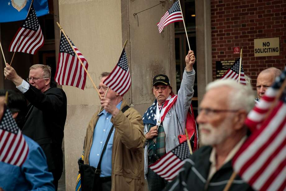 NEW YORK, NY - MAY 30: Supporters of Joe Concannon, a retired NYPD captain and current candidate for NYC City Council District 23, wave American flags during a 'Support Your Police' rally outside of Queens Borough Hall, May 30, 2017 in the Queens borough of New York City. The group also rallied against New York City Mayor Bill de Blasio. According to a campaign press release, Concannon is 'challenging the extreme left support of terrorism and anti-Semitism coming out of City Hall from the Mayor and City Council.' (Photo by Drew Angerer/Getty Images) Photo: Drew Angerer, Getty Images