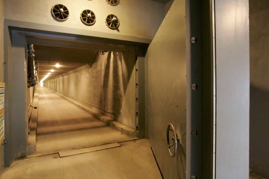 "The West Tunnel Blast Door, which weighs 25 tons and serves as an entrance to a former government relocation facility, also know as the bunker, is seen during a media tour at Greenbrier Resort July 14, 2006 in White Sulphur Springs, West Virginia. The bunker, codenamed ""Project Greek Island"" and planned by the Eisenhower Administration, was a 112,000 square-foot shelter constructed beneath the Greenbrier Resort's West Virginia Wing, to serve as a relocation site for members of the U.S. Congress and associated staff in the event of a nuclear attack on the U.S. soil. Photo: Alex Wong/Getty Images"