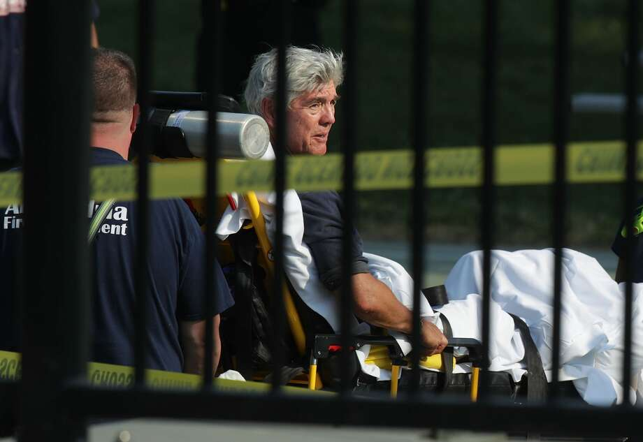 ALEXANDRIA VA- JUNE 14 U.S. Rep. Roger Williams is wheeled away by emergency medical service personnel from the Eugene Simpson Stadium Park