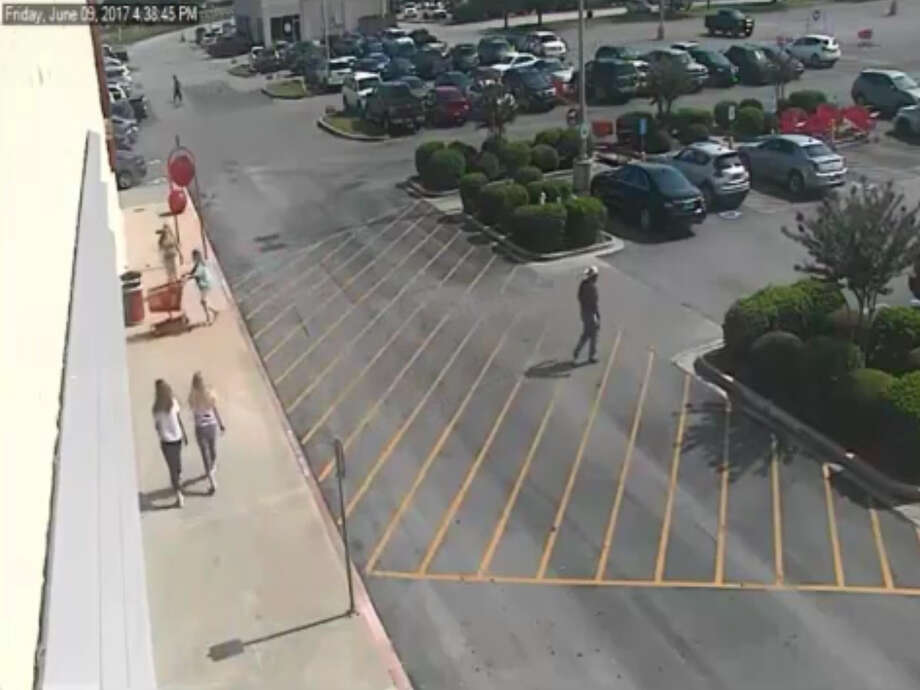 """FILE - A screenshot of surveillance footage shows a woman accused of """"keying"""" a disabled veteran's car at a Baytown-area Target department store on May 9, 2017. Investigators say she caused more than $1,000 damage to the vehicle. Photo: File/Baytown Police Department"""