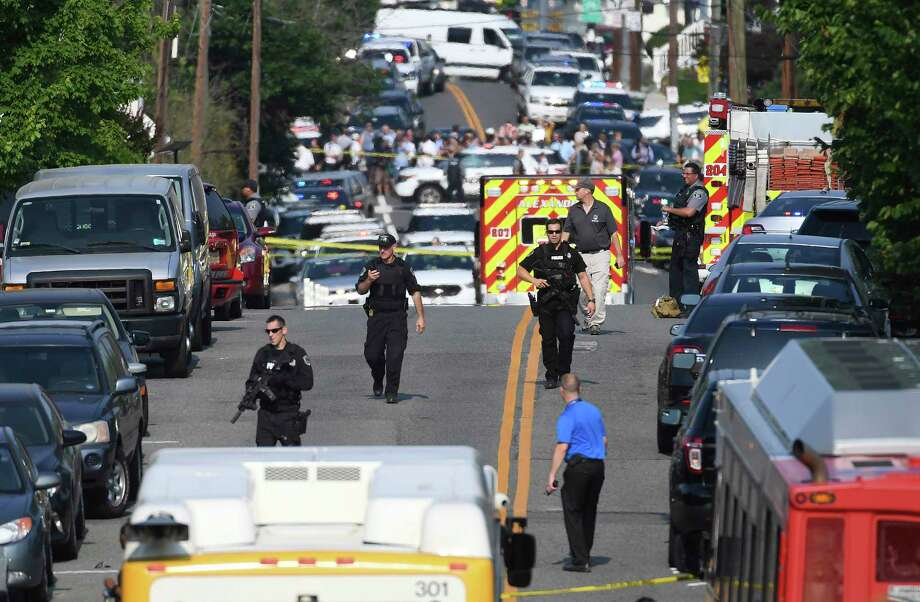 Emergency personnel respond after reports of shots fired Wednesday June 14, 2017 in Alexandria, Va.   A top House Republican, Steve Scalise of Louisiana, was shot by a rifle-wielding gunman early Wednesday at a congressional baseball practice just outside of Washington. Several other people were also wounded, officials said.  (Matt McClain/The Washington Post via AP) Photo: Matt McClain, AP / The Washington Post