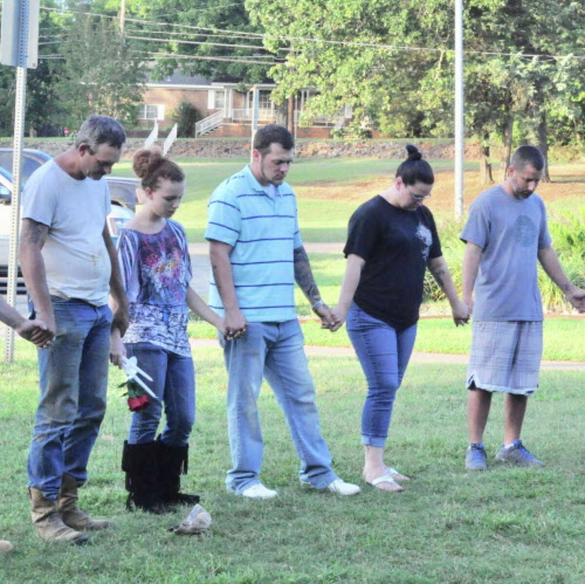 Brandy Mosley's first cousin, Danielle Melson, second from the left, shared sweet stories of her childhood with Brandy during a prayer vigil on Tuesday evening in Reagan Park in Palestine, Tx.