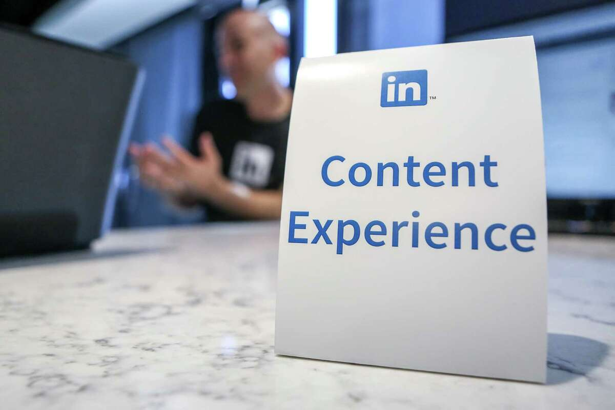 A LinkedIn employee answers questions from reporters about content experience at the company's headquarters in San Francisco in 2016. For some, the content experience on LinkedIn has become racy.
