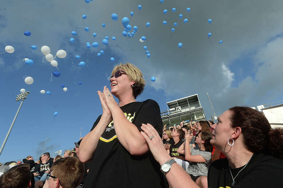Nederland Central Middle School counselors Catherine Hillsten (left) and Kerri Hays react as balloons are released at the end of a prayer vigil for the Nederland student who was accidentally shot in the head while hunting a snake Monday. Central middle School classmates, staff, and community members filled Bulldog Stadium to join in offering their prayers for the boy and his family, who are currently staying at a Houston hospital where he is being treated. Crossroads Church in Nederland and school counselor Kerri Hays are collecting donations for the family.  Photo taken Tuesday, June 13, 2017 Kim Brent/The Enterprise Photo: Kim Brent, Beaumont Enterprise / BEN