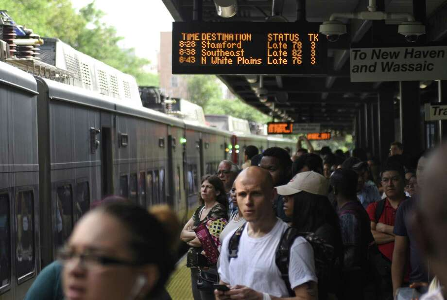 Commuters await a Stamford-bound train, arriving 78 minutes late, at the Fordham Metro-North station in Bronx, N.Y. the morning of Wednesday, June 14, 2017. An unattended bag hanging from the 138th Street Bridge caused delays between 60 and 90 minutes for all trains arriving to and departing from Grand Central Terminal. Photo: Tyler Sizemore / Hearst Connecticut Media / Greenwich Time