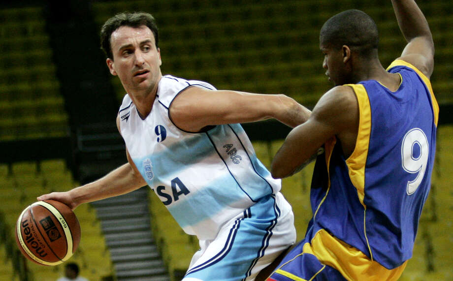 FILE - Argentina's Sebastian Ginobili (9) moves the ball passed Colombia's Stalin Ortiz (9) at a South American basketball tournament at the Poliedro arena in Caracas, Venezuela Wednesday, July 12, 2006. The older brother of Manu Ginobili will be joining the Spurs' coaching staff for Summer League next month, according to a report out of Argentina. Photo: LESLIE MAZOCH/AP