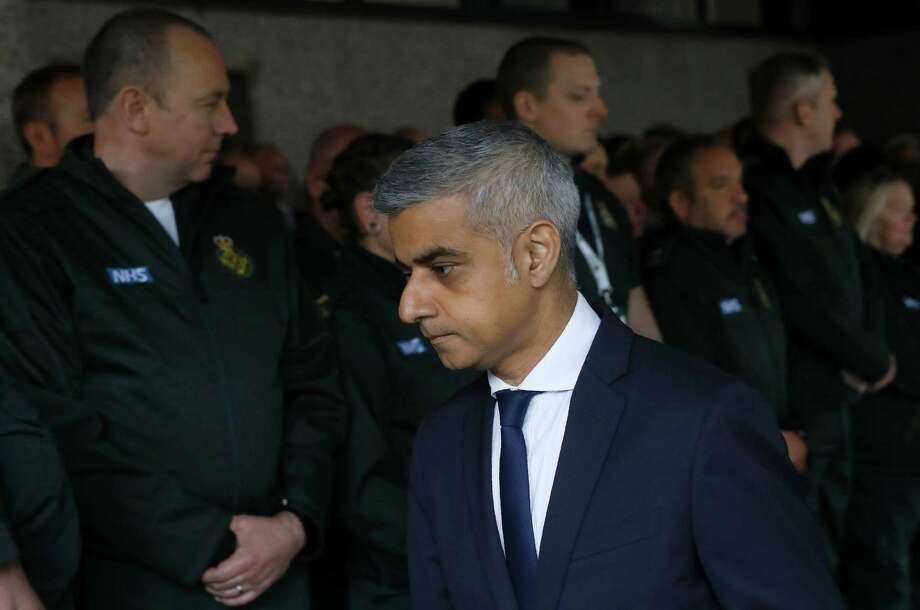 London Mayor Sadiq Khan observes a minutes of silence with London ambulance staff in in memory of the victims of the June 3 terror attacks. A reader criticizes President Trump for taking a comment made by the mayor out of context. Photo: ODD ANDERSEN /AFP /Getty Images / AFP or licensors