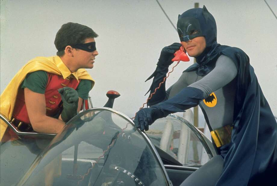 "Burt Ward as Robin watches Adam West as Batman talking on the bat phone in a scene from the television show ""Batman"" in this undated photo. West died on Friday evening. Photo: /AP / 20TH CENTURY FOX"