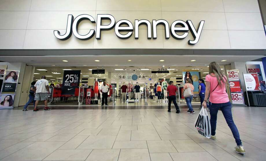 Shoppers walk into a J.C. Penney department store in Hialeah, Fla. Consumer prices edged down 0.1 percent last month following a small 0.2 percent increase in April, the Labor Department reported Wednesday. Photo: Alan Diaz /Associated Press / Copyright 2017 The Associated Press. All rights reserved.
