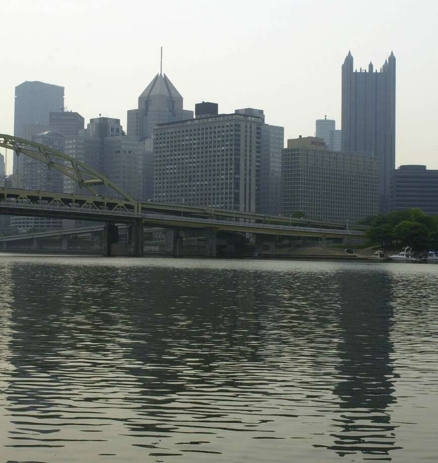 The skyline of Pittsburgh is seen through the morning haze from across the Allegeheny River. Pittsburgh is rated as having some of the nation's dirtiest air. Pulling out of the Paris Accord won't help. Photo: KEITH SRAKOCIC /AP / AP