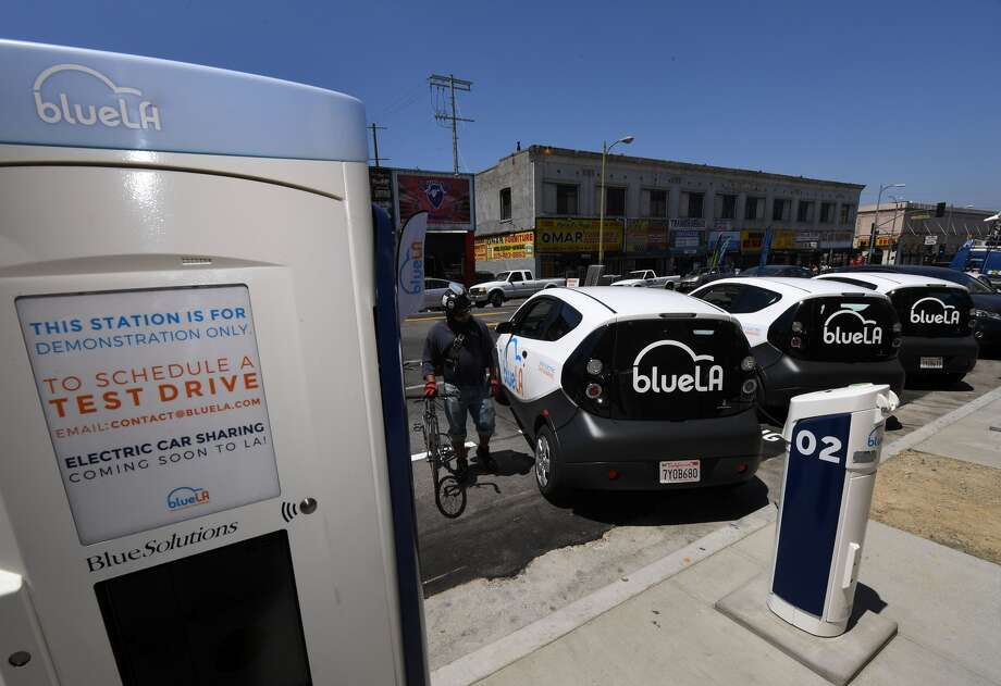 US-IT-LIFESTYLE-TRANSPORT A pay and charging station for what is being billed as the nation's largest 'Electric Vehicle' (EV) car sharing program for disadvantaged communities was unveiled by Los Angeles Mayor Eric Garcetti in Los Angeles on June 9, 2017. The service backed by the French company Blue Solutions will not be fully operational until later in 2017 and will eventually consist of 100 electric cars and 200 chargers, with self-service stations located across the city. / AFP PHOTO / Mark RALSTON (Photo credit should read MARK RALSTON/AFP/Getty Images) Restrictions Restrictions: Contact your local office for all commercial or promotional uses. Full editorial rights UK, US, Ireland, Italy, Spain, Canada (not Quebec). Restricted editorial rights elsewhere, please call local office. Details Credit: MARK RALSTON / Staff Photo: Mark Ralston / AFP / Getty Images