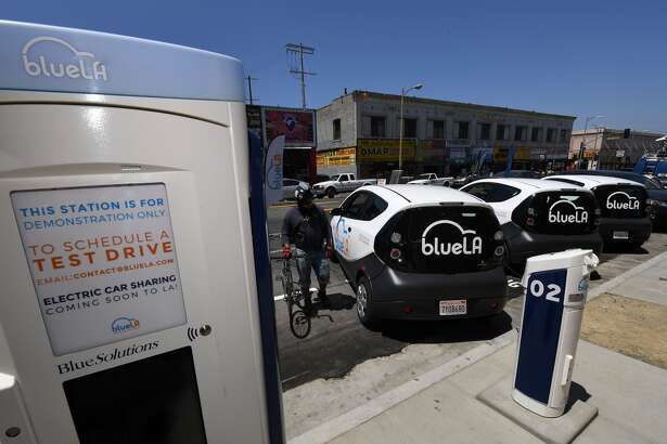 US-IT-LIFESTYLE-TRANSPORT A pay and charging station for what is being billed as the nation's largest 'Electric Vehicle' (EV) car sharing program for disadvantaged communities was unveiled by Los Angeles Mayor Eric Garcetti in Los Angeles on June 9, 2017. The service backed by the French company Blue Solutions will not be fully operational until later in 2017 and will eventually consist of 100 electric cars and 200 chargers, with self-service stations located across the city. / AFP PHOTO / Mark RALSTON (Photo credit should read MARK RALSTON/AFP/Getty Images) Restrictions Restrictions: Contact your local office for all commercial or promotional uses. Full editorial rights UK, US, Ireland, Italy, Spain, Canada (not Quebec). Restricted editorial rights elsewhere, please call local office. Details Credit: MARK RALSTON / Staff