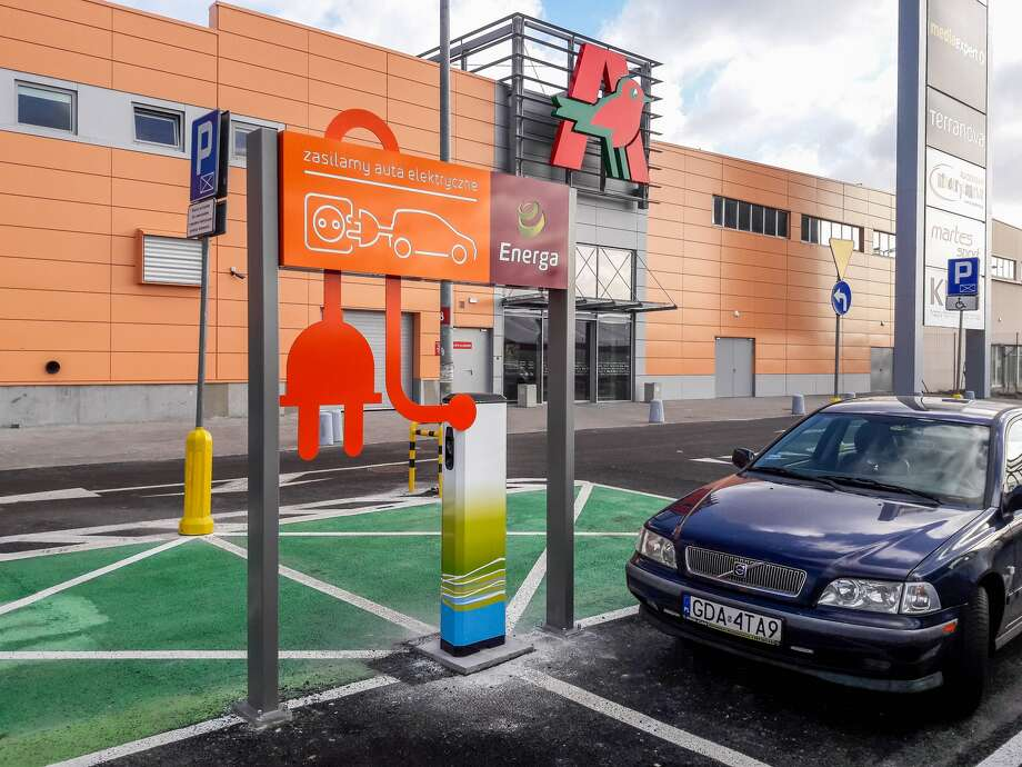 A free public charging station for electric vehicles was installed in March 2017 at this shopping mall in Poland.  Photo: Michal Fludra / Getty Images
