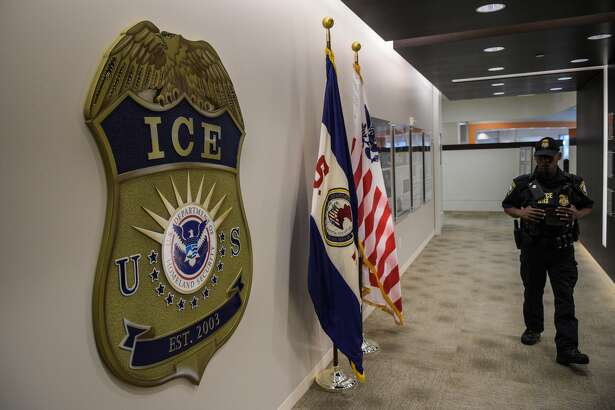 WASHINGTON, DC - MAY 11: A law enforcement officer walks past ICE logo ahead of a press conference on Thursday, May 11, 2017, at the U.S. Immigration and Customs Enforcement headquarters in Washington, DC. (