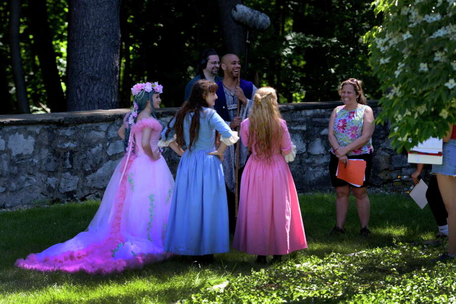 "Director Ann Marie Lizzi, right, works with her actors during the production of the episode ""Rapunzel"" for Amazon TV's ""The Adventures of Snow White and Rose Red"" on North Broadway on Wednesday, June 14, 2017, in Saratoga Springs, N.Y. (Skip Dickstein/Times Union) Photo: SKIP DICKSTEIN, Albany Times Union / 20040787A"