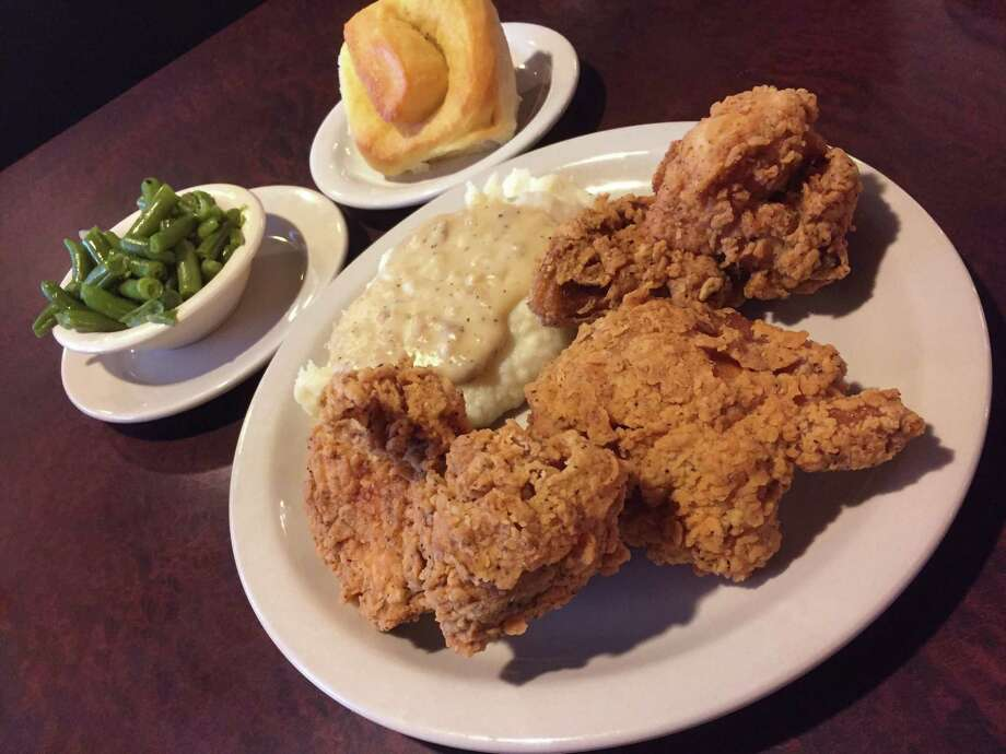 Fried chicken with mashed potatoes, green beans and roll from Earl Abel's Photo: Staff File Photo / San Antonio Express-News