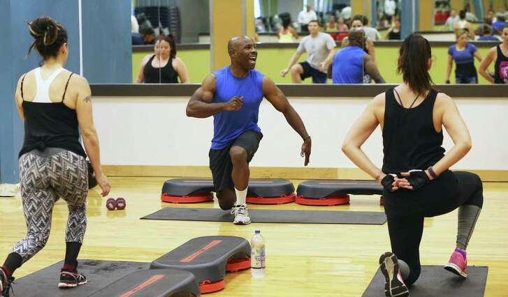 Carlton Moment leads the group as patrons through a high-intensity interval training class. at Gold's Gym in the Alamo Quarry Market. This type of workout has been around for years but is now enjoying a renaissance of popularity.