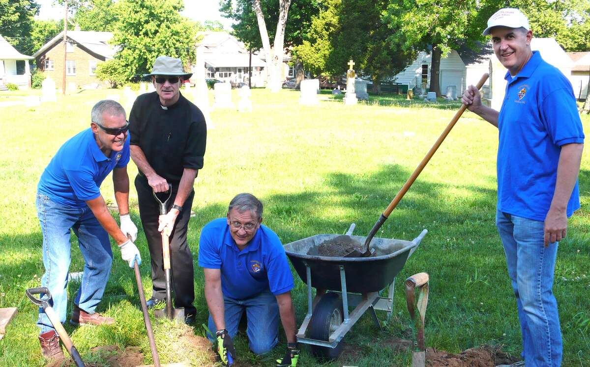 Working at St. Mary's Cemetery recently are, from left: Jerry Kapp, St. Mary's pastor Fr. Dan Bergbower, Dennis Hessel and Jim Jatcko.