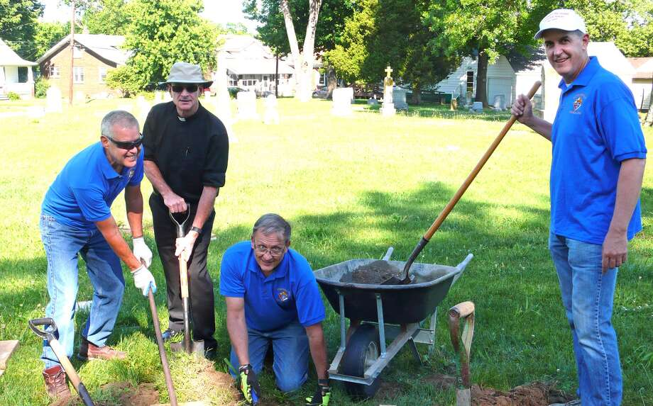 Working at St. Mary's Cemetery recently are, from left: Jerry Kapp, St. Mary's pastor Fr. Dan Bergbower, Dennis Hessel and Jim Jatcko. Photo: For The Intelligencer