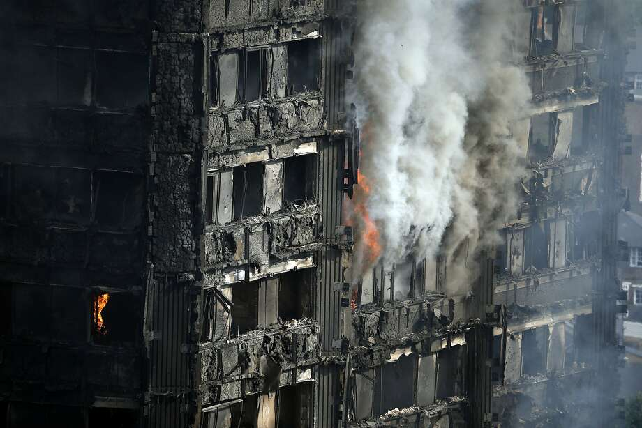 "Parts of the apartment building still burn hours after a deadly blaze in west London. ""In my 29 years of being a firefighter, I have never, ever seen anything of this scale,"" Fire Commissioner Dany Cotton said. Photo: Alastair Grant, Associated Press"