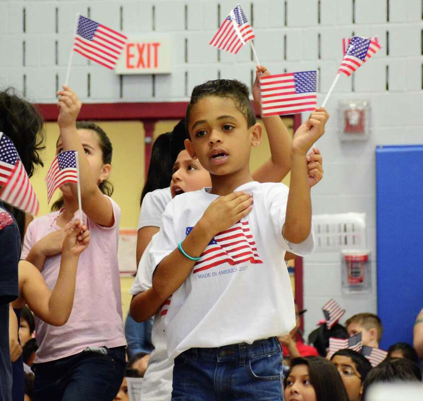 Kevin Barbosa says the Pledge of Allegiance during a celebration at Ellsworth Avenue Elementary School for Flag Day on Wednesday June 14, 2017.