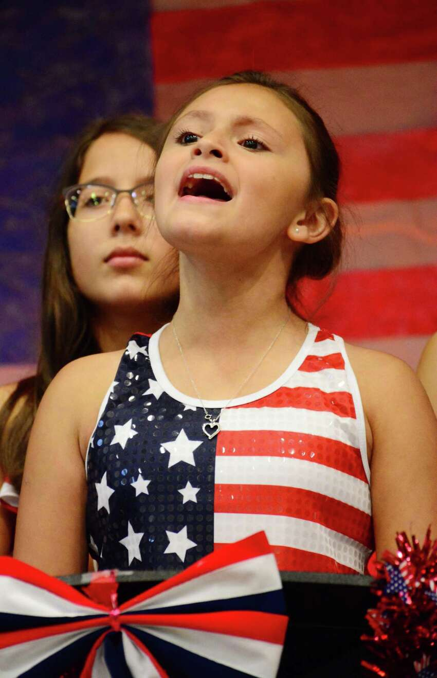 Aralyn Cooper sings a patriotic song during Ellsworth Avenue Elementary Schools Flag Day celebration on Wednesday June 14, 2017.