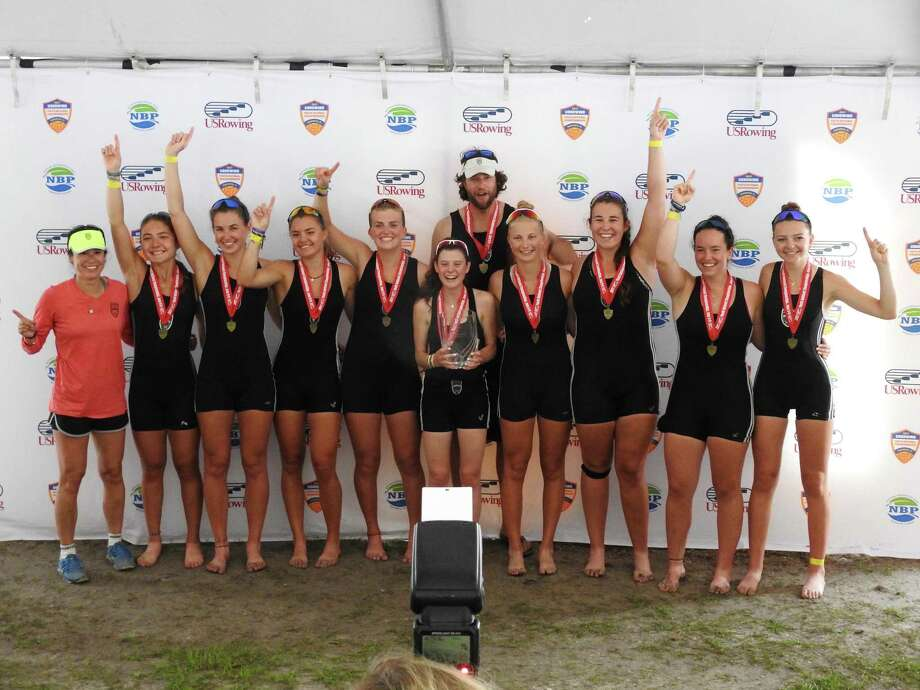 Caitlin Esse of New Canaan and teammates celebrate after three-peating as national champions in the womens youth 8+ event at youth nationals. L-R: SRC assistant girls coach Anna Yamamoto, Noelle Amlicke, Westport; Kelsey McGinley, Westport; Imogen Ratcliffe, Westport; Willemijn ten Cate, Westport; coxswain Charlotte Powers, Fairfield; SRC girls head coach Gordon Getsinger; Tatiana Chermayeff, Rowayton; Grace McGinley, Westport; Caitlin Esse, New Canaan; and Sophie Pendrill, Scarsdale, NY. Photo: Contributed Photo / New Canaan News contributed