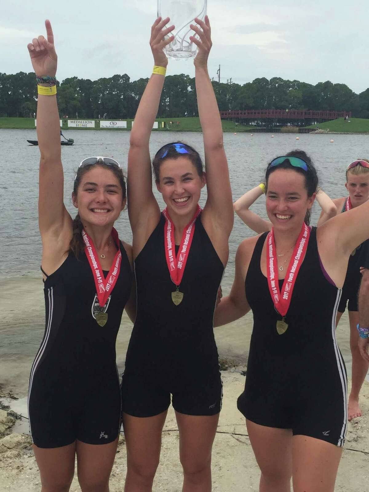 Caitlin Esse of New Canaan (R) celebrates with teammates after winning the womens youth 8+ national championship.