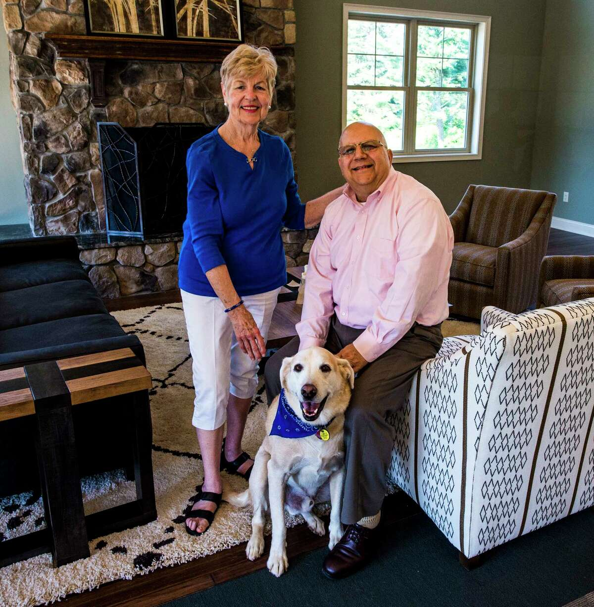 Pat and Charlie Giglio enjoy their time with Tanner the lab in the clubhouse of Mill Hollow Apartments Monday June 12, 2017 in Altamont, N.Y. (Skip Dickstein/Times Union)