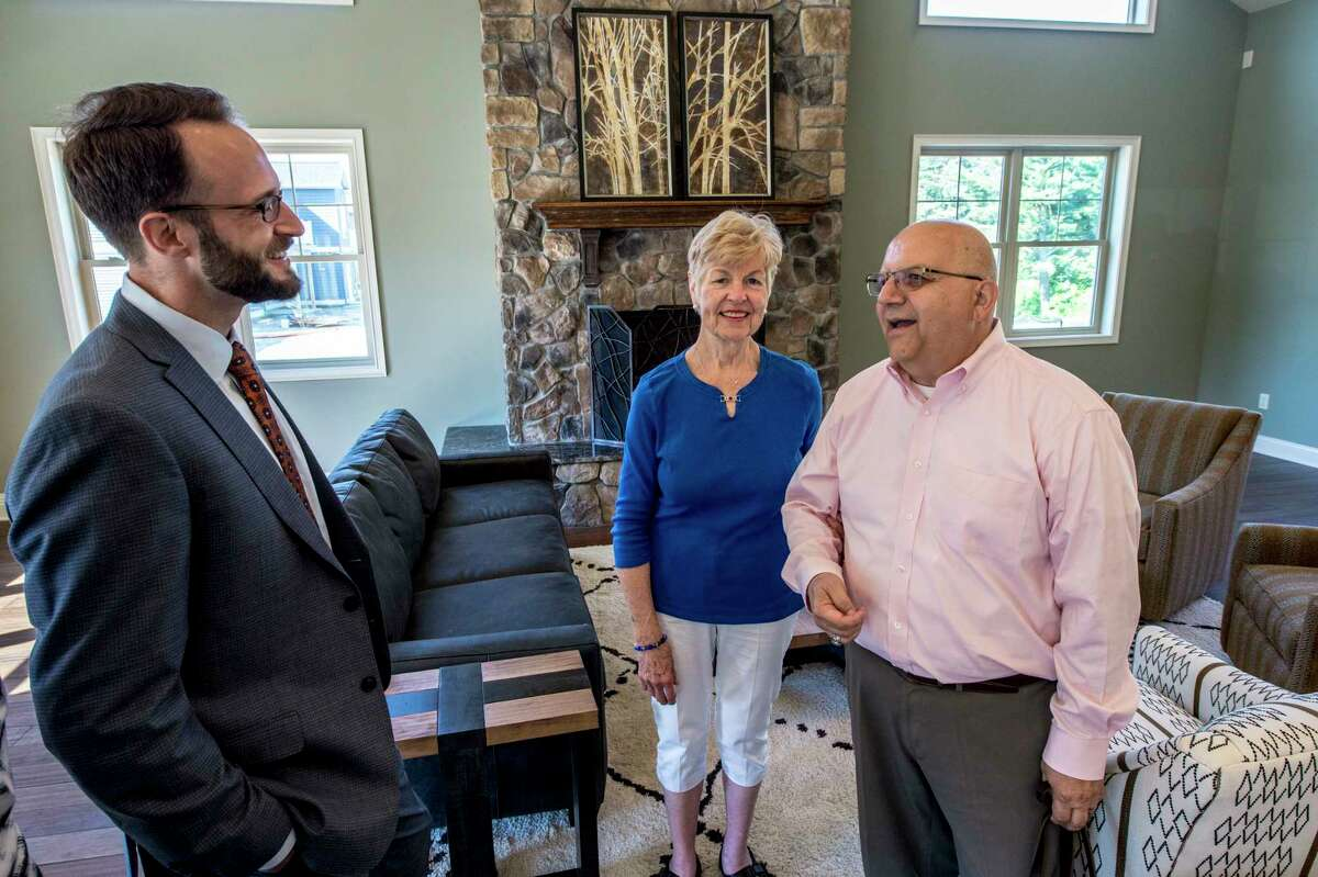 Pat and Charlie Giglio speak with developer James Cerseput in the clubhouse of Mill Hollow Apartments Monday June 12, 2017 in Altamont, N.Y. (Skip Dickstein/Times Union)
