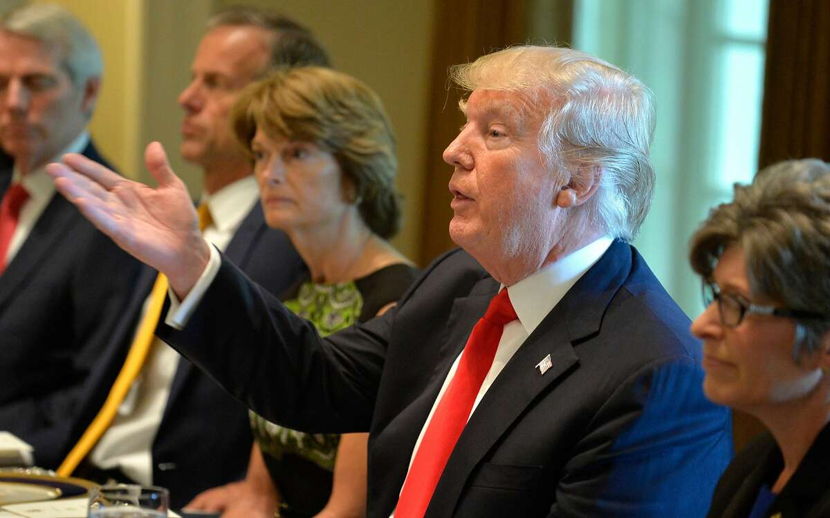WASHINGTON, DC - JUNE 13: President Donald Trump hosts a working lunch with members of Congress, including Alaska Sen. Lisa Murkowski (L) at the White House, June 13, 2017, in Washington, DC. Trump and lawmakers discussed administration plans to reform the Affordable Care Act, also known as Obamacare. (Photo by Mike Theiler-Pool/Getty Images)