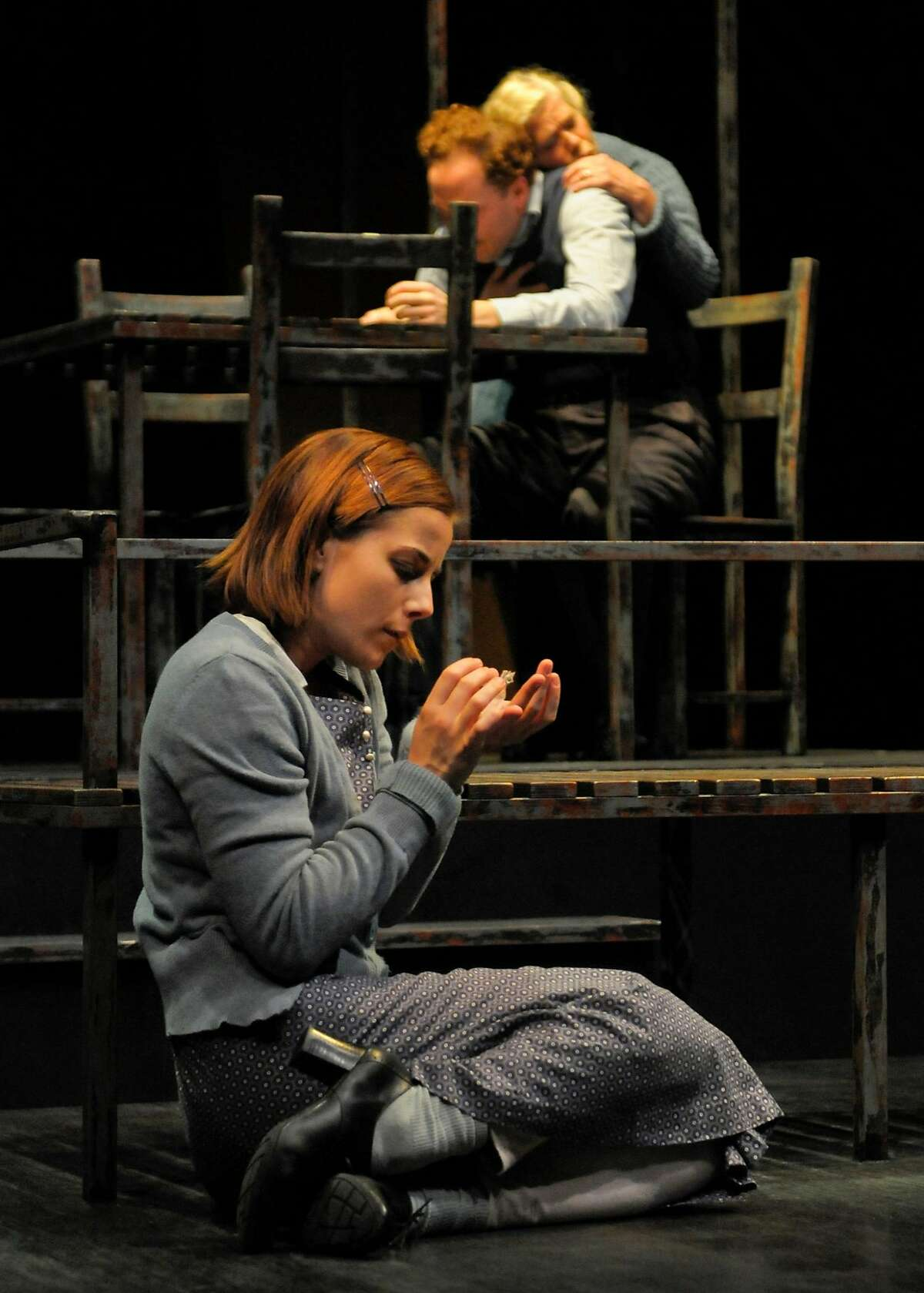 """Laura (Anna Bullard) withdraws in her private world as her mother Amanda (Sherman Fracher, above left) and brother Tom (Nicholas Pelczar) argue in Marin Theatre Company's """"The Glass Menagerie"""""""