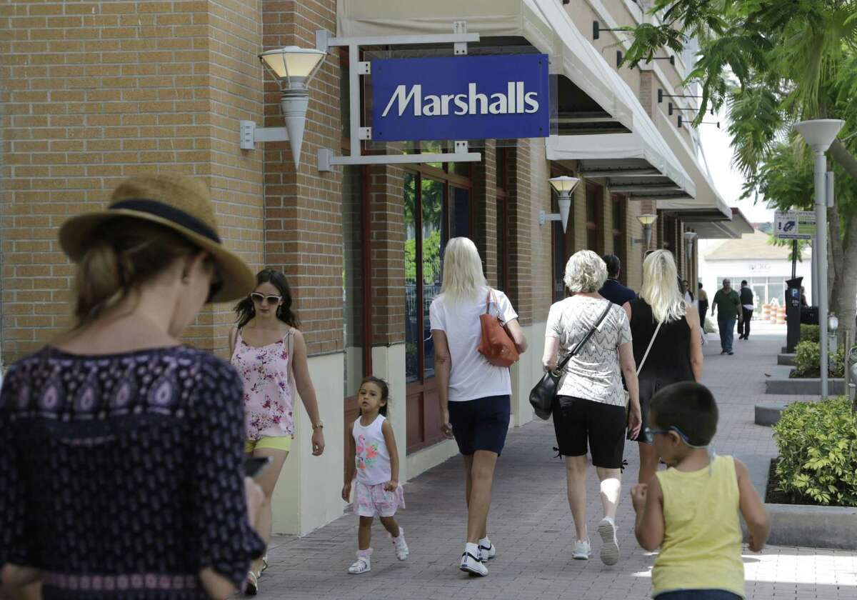 Shoppers walk past a Marshalls in Miami. On Wednesday, the Commerce Department said that retail sales dropped 0.3 percent, the first decline since February and the sharpest since a 1 percent decrease in January 2016.