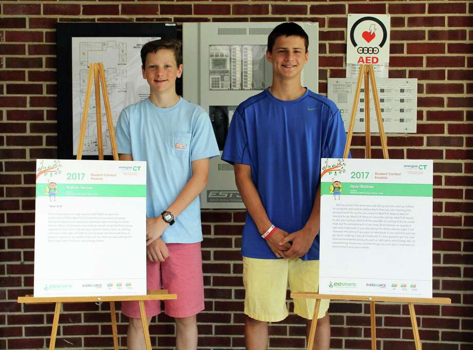 William Harper, left, and Ryan Blatney of Darien won a contest for writing a public service annoucement on saving energy. Photo: Erin Kayata / Hearst Connecticut Media / Darien News