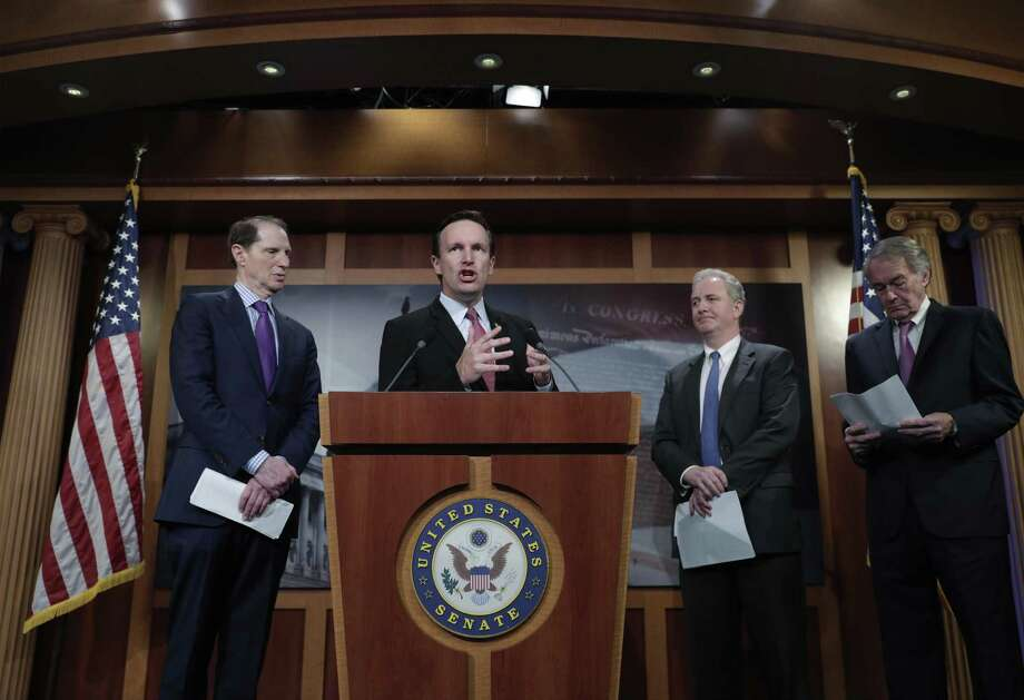 U.S. Sen. Chris Murphy, D-Conn., center, criticizes the tax breaks in the GOP-authored American Health Care Act, on Capitol Hill in Washington June 6. Photo: J. Scott Applewhite / Associated Press / AP