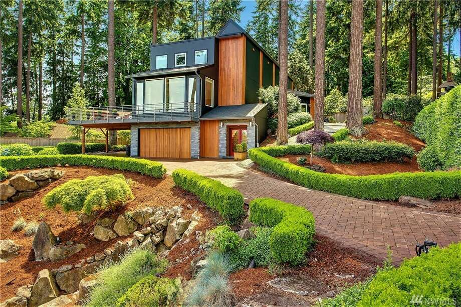 This home at 9603 S.E. 61st Place was built in 1985 and designed by noted Seattle architecture firm Stuart Silk. The four bedroom, three bathroom home sits on nearly a half acre. The home is listed for $2.25 million. You can see the full listing here. Photo: Photos By JWPhoto – John G. Wilbanks Photography, Inc./listing Courtesy Pamela Richmond, Coldwell Banker Bain