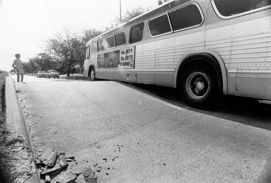 Jun 25, 1978: Temperatures in the 90s Saturday caused more than sunburn -- they also buckled pavement in the 5600 block of West Bellfort about three blocks west of Chimney Rock. The driver of this HouTran bus, who refused to give his name, had to wait for a tow truck to get his bus off high center. Photo: Othell O. Owensby Jr., Houston Chronicle / Houston Chronicle